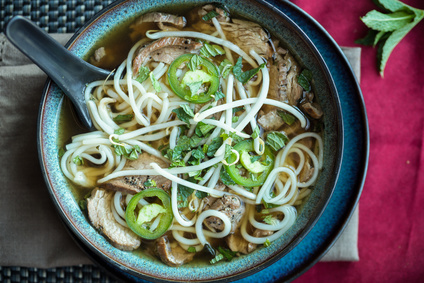 Vietnamese beef Pho soup with jalapeno mint and bean sprouts